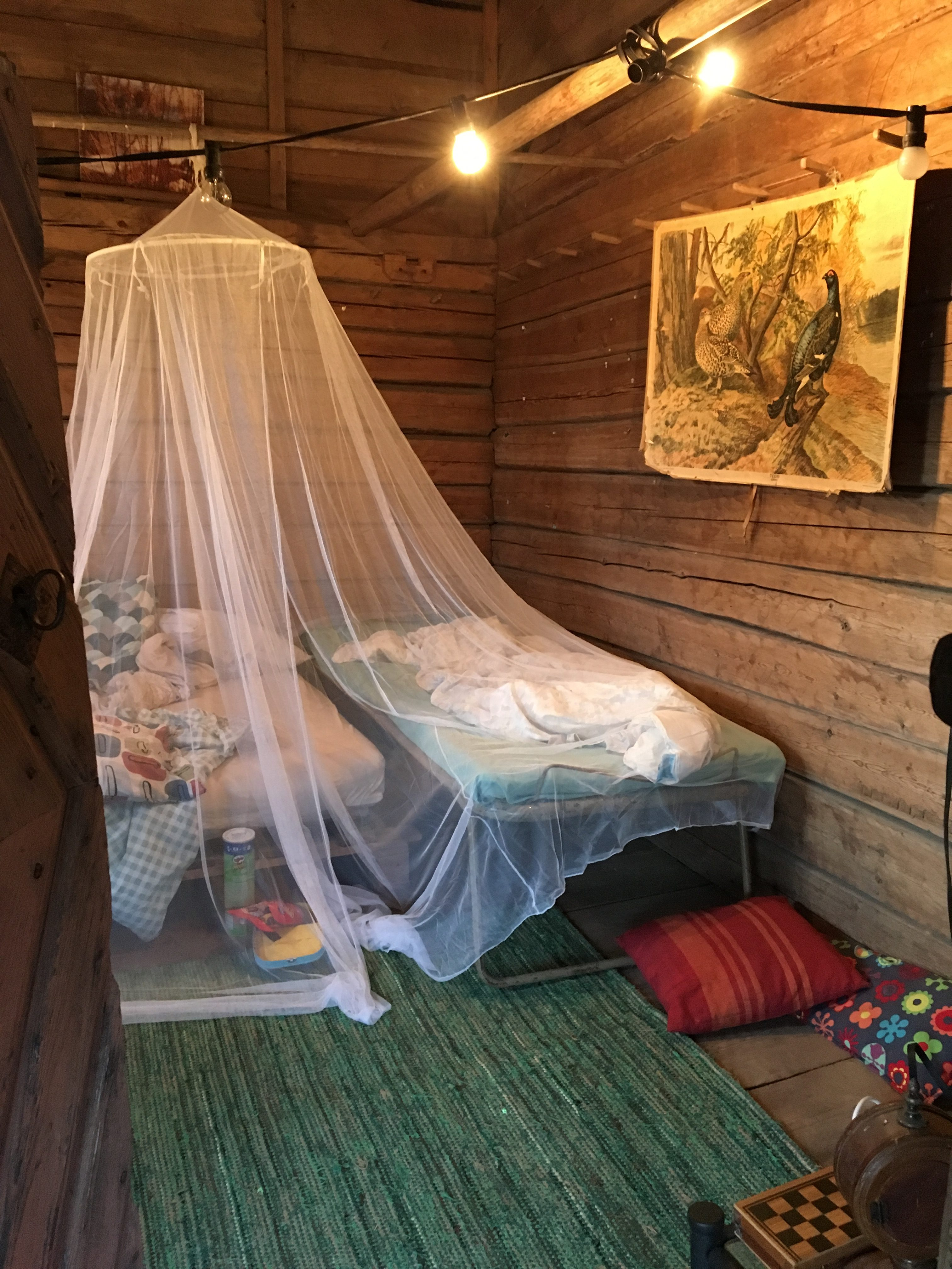 Mosquito net on bed, old barn as summerhouse, summerhouse, Ikea mosquito net