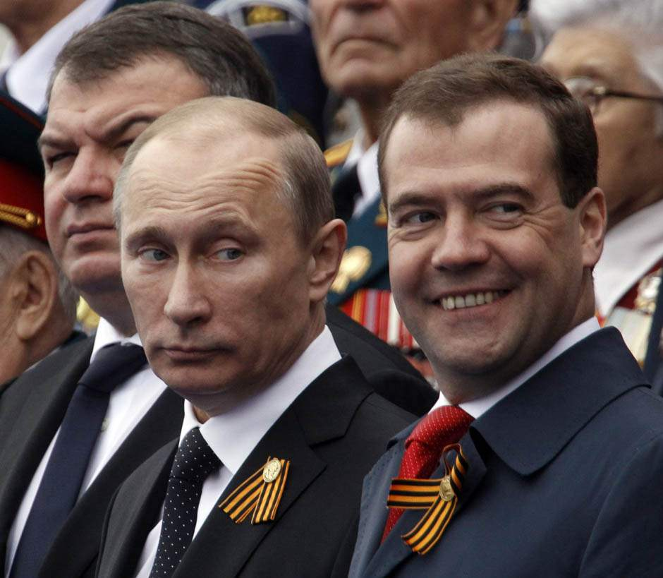 Russian President Vladimir Putin (C), Prime Minister Dmitry Medvedev (R) and acting Defence Minister Anatoly Serdyukov (L) watch the Victory Parade on Moscow's Red Square. Photo: REUTERS/Sergei Karpukhin.